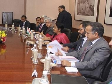 File image of Sushma Swaraj flanked by diplomates. Twitter @MEAIndia
