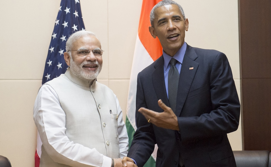 US President Barack Obama (R) shakes hands with India's Prime Minister Narendra Modi prior to a meeting on the sidelines of the Association of Southeast Asian Nations (ASEAN) Summit in Vientiane. AFP
