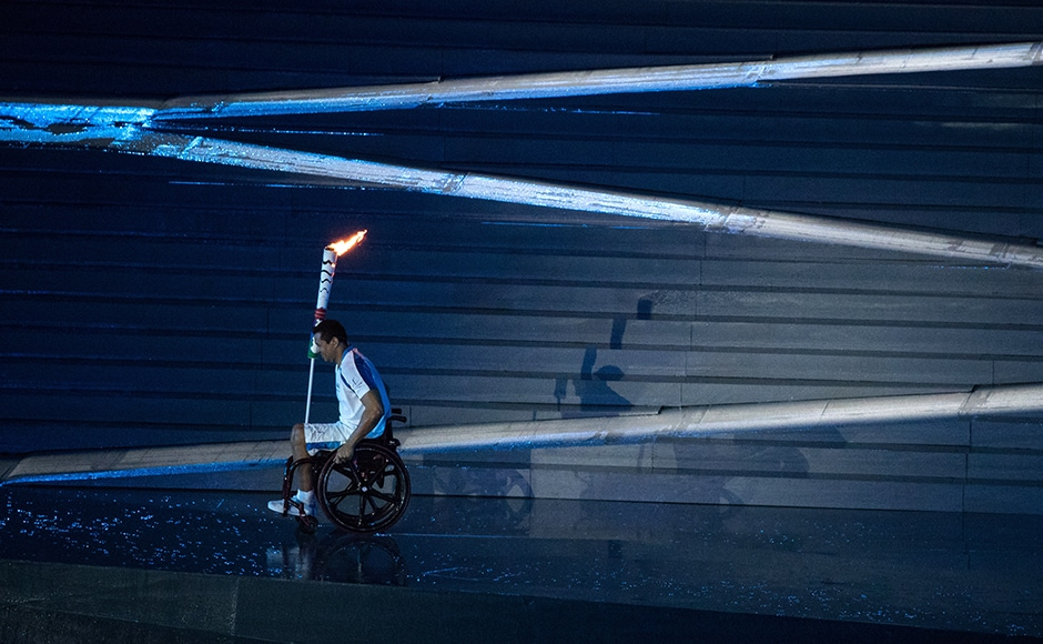 2016 Rio Paralympics - Opening ceremony - Maracana - Rio de Janeiro, Brazil - 07/09/2016. Brazilian Paralympic swimmer Clodoaldo Silva carries the torch during the opening ceremony. REUTERS/