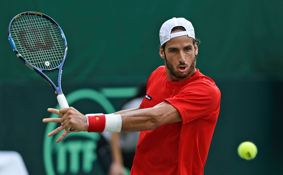 Spain's Feliciano Lopez plays a shot in his Davis Cup men's tie against India's Ramkumar Ramanathan in New Delhi, India, Friday, Sept. 16, 2016. (AP Photo/Saurabh Das)