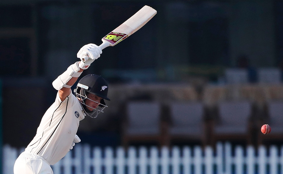 New Zealand's Mitchell Santner bats on the fourth day of their first cricket test match against India at Green Park Stadium in Kanpur, India, Sunday, Sept. 25, 2016. (AP Photo/ Tsering Topgyal)