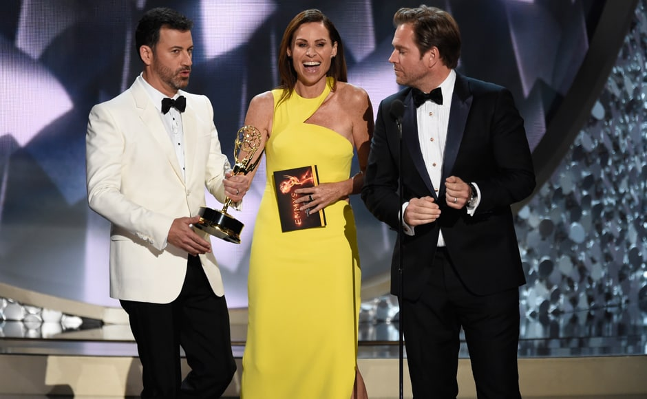 Host Jimmy Kimmel, left, takes the Emmy Award from presenters Minnie Driver, center, and Michael Weatherly after announcing Maggie Smith was the winner of the best supporting actress award for her role in 'Downton Abbey' at the 68th Primetime Emmy Awards on Sunday, Sept. 18, 2016, at the Microsoft Theater in Los Angeles. (Photo by Chris Pizzello/Invision/AP)