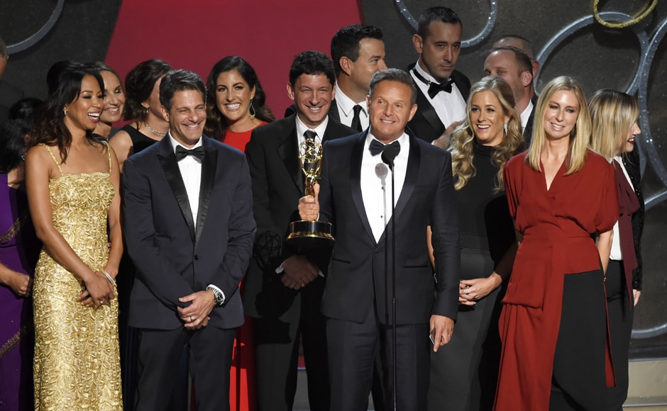 Mark Burnett and the cast and crew of 'The Voice' accepts the award for outstanding reality-competition program at the 68th Primetime Emmy Awards on Sunday, Sept. 18, 2016, at the Microsoft Theater in Los Angeles. (Photo by Chris Pizzello/Invision/AP)