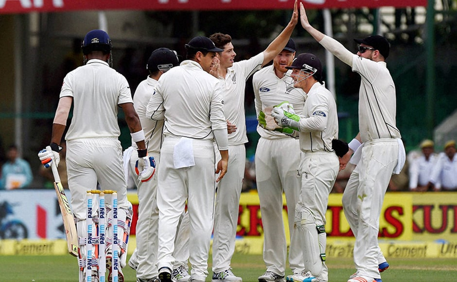 New Zealand seamer Mitchell Santner celebrates with his teammates after dismissing K.L. Rahul on the opening day of the first Test match at Green Park in Kanpur on Thursday. PTI Photo(PTI9_22_2016_000037B)