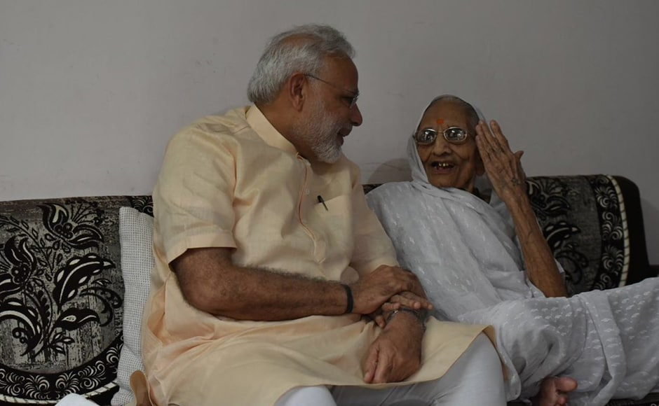PM Modi interacts with his mother on his birthday in Gandhinagar. Modi celebrated his 66th birthday with his mother Hiraba, tribals and specially-challenged people in Gujarat. PTI