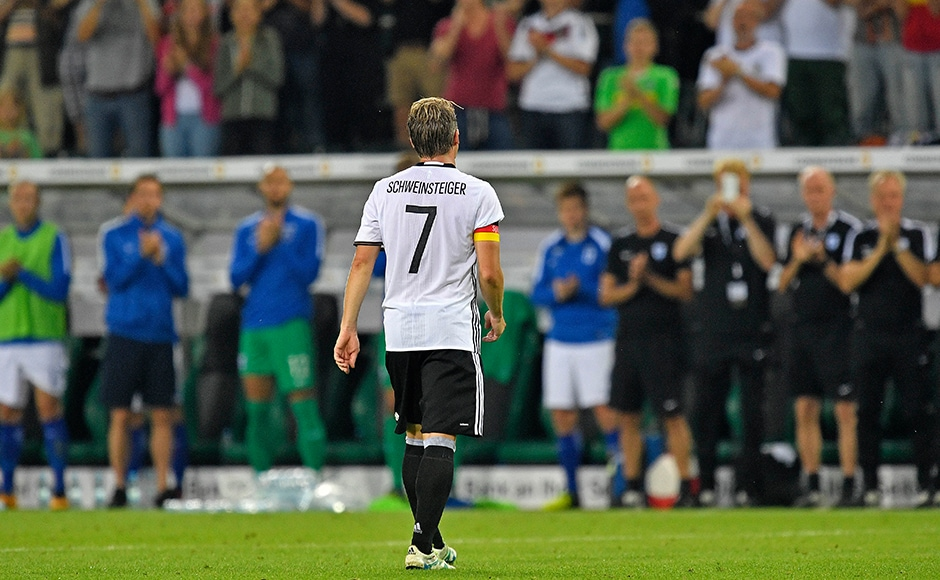 Germany's captain Bastian Schweinsteiger leaves the pitch during a friendly soccer match between Germany and Finland in Moenchengladbach, Germany, Wednesday, Aug. 31, 2016. Schweinsteiger made his last match for the national team.AP