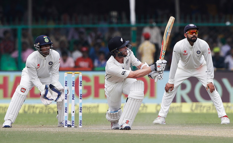 New Zealand's Captain Kane Williamson, center, plays a shot during the second day of their cricket test match against India at Green Park stadium in Kanpur, India, Friday, Sept. 23, 2016.AP