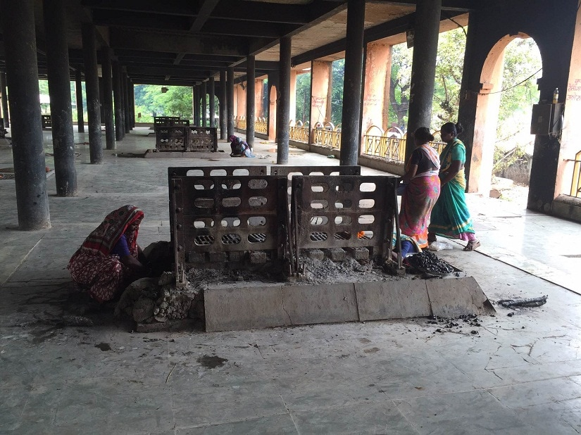 Matang women earn their livelihood by segregating the ashes after a cremation