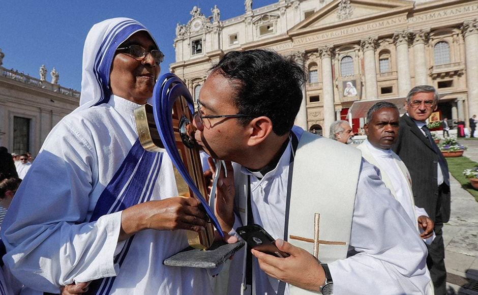 A priest kisses the relics of Mother Teresa prior to the start of a Mass celebrated by Pope Francis. AP