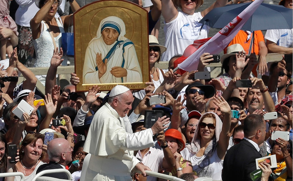 Declaring Mother Teresa a saint, Pope Francis makes her the model of his Jubilee Year of Mercy and in some ways his entire papacy. The Pope passes in front a portrait of Mother Teresa at the end of the canonization ceremony in St. Peter's Square at the Vatican. AP