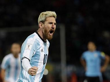 Argentina's Lionel Messi celebrates scoring against Uruguay. AP