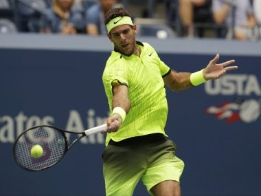 Juan Martin del Potro returns a shot to Dominic Thiem during the fourth round. AP