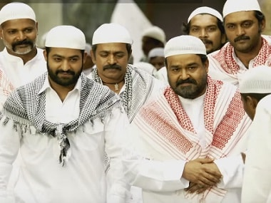 Junior NTR and Mohanlal in a still from 'Janatha Garage'. Screengrab from YouTube