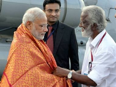 Prime Minister Narendra Modi being received by Kerala-BJP President Kummanam Rajashegaran at airport in Kozhikode on Saturday. PTI