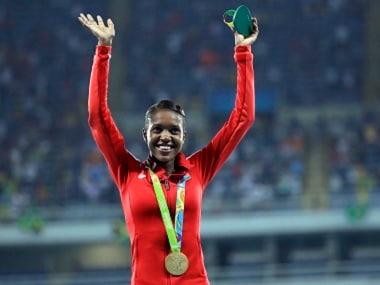 Kenya's gold medal winner Faith Kipyegon waves during the medal ceremony. AP