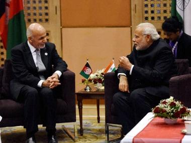 Mohammad Ashraf Ghani with PM Modi. PTI