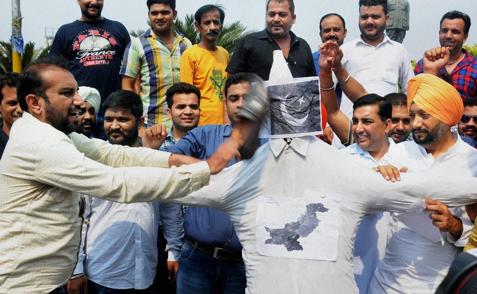 While Congress targeted PM Modi for the attacks, some party workers protested against the attack in Amritsar by slapping their shoes on the Pakistan flags.