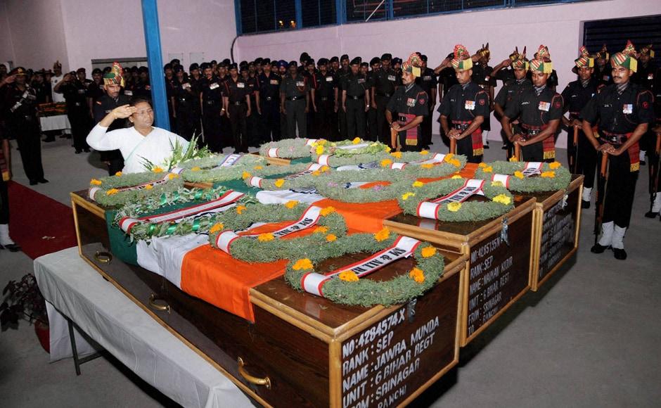Jharkhand Governor Droupadi Murmu offering tribute to slain Army jawans Jawra Munda, Nayan Kumar and S K Vidyarthi in Ranchi on Monday. Army jawans died in a terror attack at Uri near Line of Control on Sunday morning. PTI