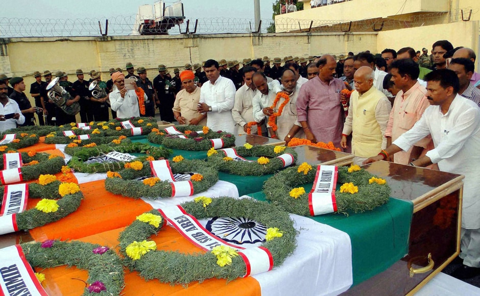 People pay homage to seven army soldiers who were killed in the Uri attack, at Babatpur Airport in Varanasi on Monday. PTI