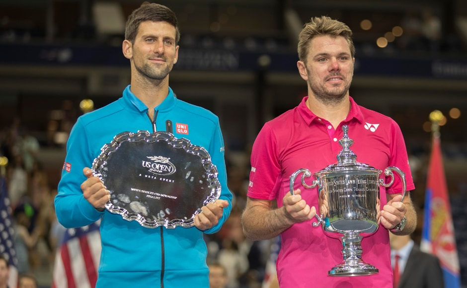 Novak Djokovic and Stan Wawrinka pose for pictures at the trophy presentation ceremony after their epic final battle at the 2016 U.S. Open tennis tournament. Warinka is now 3-0 in major grand slam finals. Susan Mullane/USA TODAY Sports