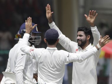 Ravindra Jadeja (R) celebrate a wicket against New Zealand with his team-mates on Day Three of 1st Test in Kanpur. AP