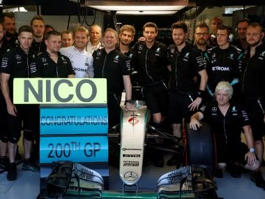 Mercedes' Nico Rosberg  poses for photos to mark his 200th Grand Prix. Reuters