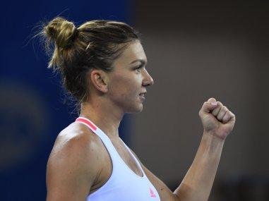 Simona Halep of Romania celebrates her win in her quarter-final. AFP