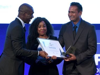 FIFA General Secretary Fatma Samoura and Clarence Seedorf presents the FIFA Diversity Award to Abhijeet Barse from Slum Soccer during the Soccerex Global Convention. AFP