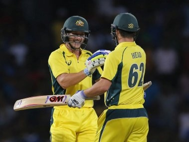 Australia's Travis Head and Peter Nevill celebrate their team's victory over Sri Lanka. AP