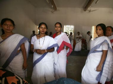 Women inmates watch visitors from their cell in a prison in Kolkata. Reuters
