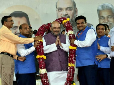 Amit Shah being felicitated in Surat. PTI