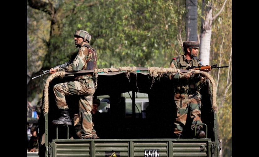 Soldiers guard outside the army base in Uri. PTI