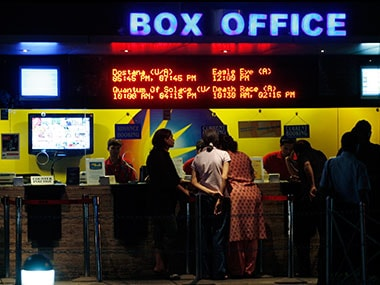 People buy tickets at a counter in a multiplex movie theatre in Mumbai. Reuters