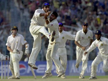 Indian players exult as Australia's Glenn Mcgrath looks on after India won the second Test match at Eden Gardens in March, 2001. AFP