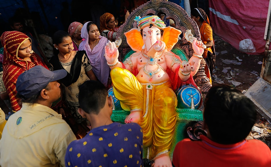 Indians carry an idol of Ganesha on the eve of Ganesh Chaturthi festival in Ahmedabad. The idol will be immersed in water bodies after worship at the end of the festival. AP