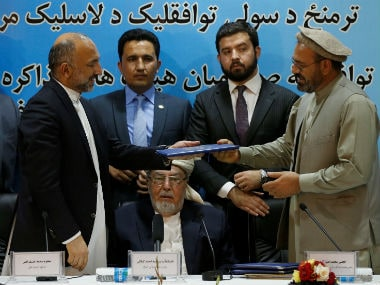 Representatives of the Afghanistan government and Hekmatyar sign a peace deal. Reuters