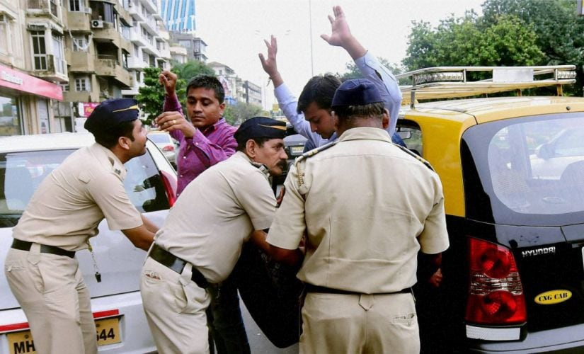 Mumbai police check passengers at a checkpost after a high alert was issued. PTI