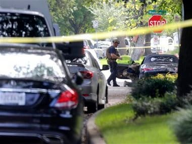 Police investigate the car believed to belong to the alleged shooter at the scene of a shooting in Houston. AP