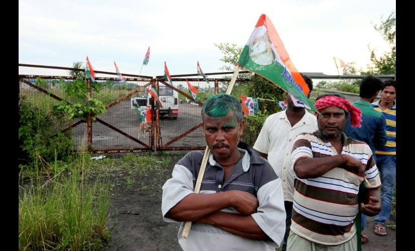 Trinamool Congress supporters in front of the gates of the deserted factory in Singur. Firspost/Saadia Azim