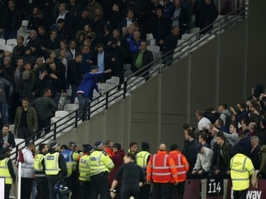 Supporters of both sides confront each other during the League Cup match between West Ham United and Chelsea. AFP