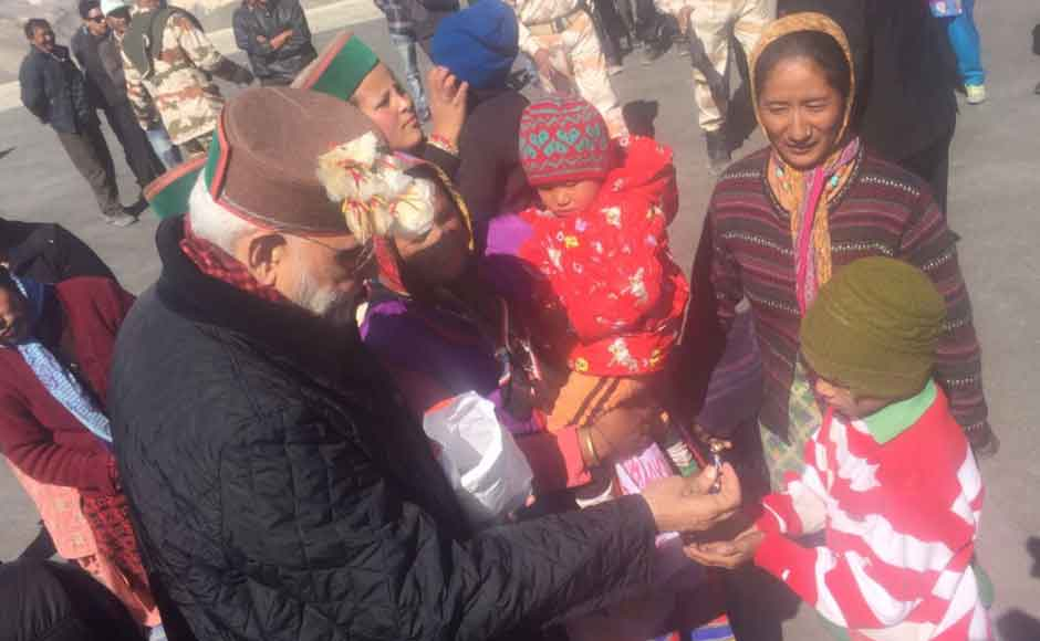 Villagers taken aback by the Prime Minister's arrival raised slogans hailing him. Dressed in warm clothes, Modi spent time with the residents of the village including women and children. (Photo: Twitter@ narendramodi)
