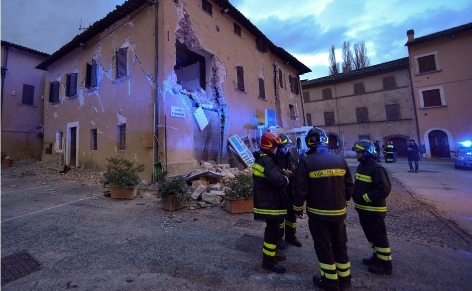 Firfighters inspect the damages in Visso, central Italy, Thursday, Oct 27, 2016, following an earthquake that destroyed part of the neighborhood. A pair of strong aftershocks shook central Italy late Wednesday, crumbling churches and buildings, knocking out power and sending panicked residents into the rain-drenched streets just two months after a powerful earthquake killed nearly 300 people. (AP Photo/Sandro Perozzi)