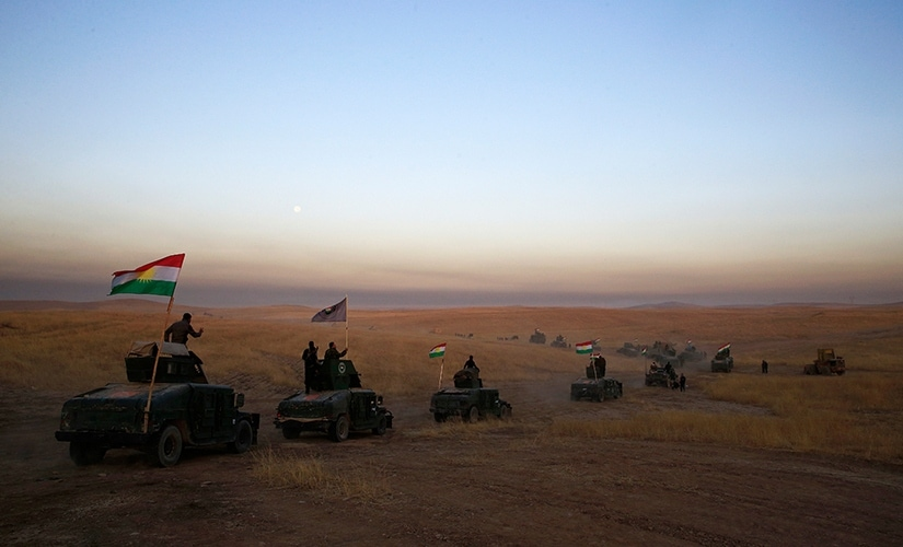 Convoys of Iraqi, Kurdish and US forces moved east of Mosul along the front line as US-led coalition airstrikes sent plumes of smokes into the air and heavy artillery rounds could be heard. This Peshmerga convoy is headed towards a frontline in Khazer, about 30 kilometers (19 miles) east of Mosul, Iraq. AP