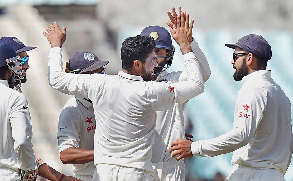 Indian players celebrate the fall of a wicket on the fourth day of the second Test match against New Zealand at Eden Garden in Kolkata on Monday. PTI Photo by Ashok Bhaumik (PTI10_3_2016_000063B)