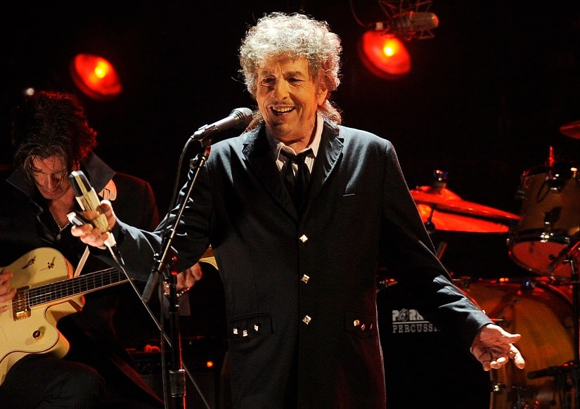 FILE - In this Jan. 12, 2012, file photo, Bob Dylan performs in Los Angeles. Dylan was named the winner of the 2016 Nobel Prize in literature Thursday, Oct. 13, 2016, in a stunning announcement that for the first time bestowed the prestigious award to someone primarily seen as a musician. (AP Photo/Chris Pizzello, File)