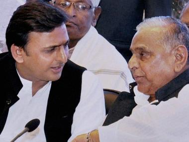Akhilesh Yadav with SP supremo Mulayam Singh Yadav. PTI