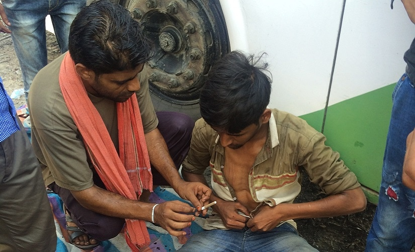 An addict taking smack out in the open. Firstpost/Pallavi