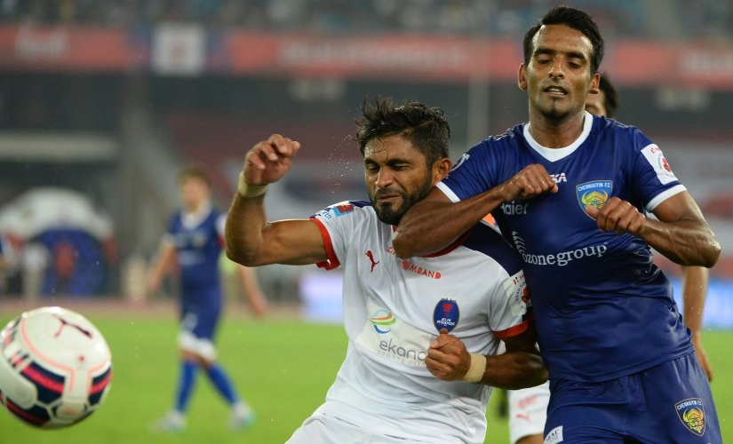 Delhi Dynamos FC Indian defender Anas Edathodika (L) and Chennaiyin FC Indian midfielder Harmanjot Khabra tussle for the ball during the ISL 2015 season. AFP