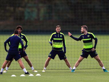 Arsenal's Mohamed Elneny, Mesut Ozil, Shkodran Mustafi practice. AP