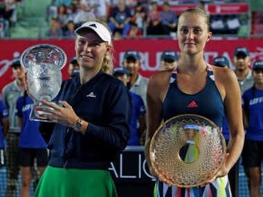Caroline Wozniacki and Kristina Mladenovic with their trophies after the Hong Kong Open final. Reuters